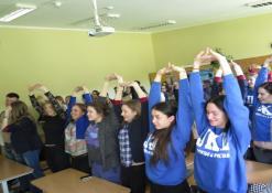Mokiniai dalyvauja paskaitoje