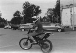 Motociklininko portretas