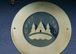 """""""Teku Taku"""" tipio emblema"""